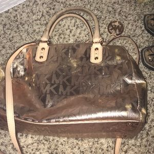 Rose gold Michael kors purse